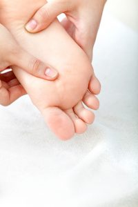 Person massaging a foot